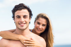 Happy couple in swimsuit looking at camera and embracing Royalty Free Stock Photo