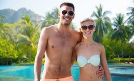 Happy couple in swimwear hugging over hotel resort Stock Image