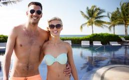 Happy couple in swimwear hugging over hotel resort Royalty Free Stock Photo