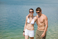 Happy couple in swimwear at sea enjoy sun Royalty Free Stock Photos