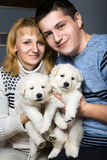 Happy Couple With Swiss Shepherd Puppy Stock Images