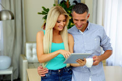Happy couple with tablet computer Stock Photos