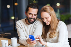 Happy couple with tablet pc and coffee at cafe Royalty Free Stock Image