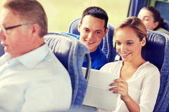 Happy couple with tablet pc in travel bus royalty free stock photo