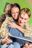 Happy couple with tablet pc Royalty Free Stock Images