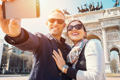 Happy couple take a selfie photo on the Arch of Peace in Milan Stock Image