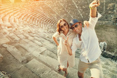 Happy couple take a selfie photo on the steps of antique ruins Royalty Free Stock Photography