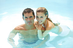 Happy Couple Taking A Bath In Pool Stock Photo