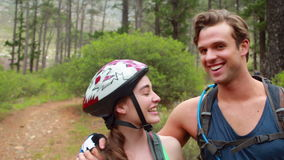 Happy couple taking a break while biking. In the nature stock video footage