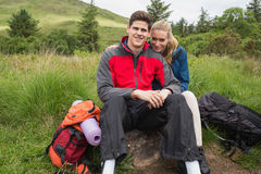Happy couple taking a break on a hike Stock Photo