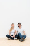 Happy couple taking a break during a house move Royalty Free Stock Photos
