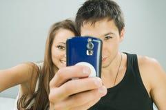 Happy couple taking a photo Stock Image