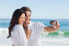 Happy couple taking a photo Royalty Free Stock Photo