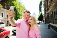 Happy couple taking photo of themselves Royalty Free Stock Photos