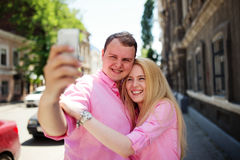 Happy couple taking photo of themselves Royalty Free Stock Photography