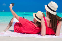 Happy couple taking a photo themselves on tropical beach Royalty Free Stock Image