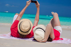 Happy couple taking a photo themselves on tropical beach Stock Image
