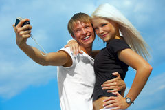 Happy couple is taking a picture Stock Image