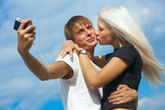 Happy couple is taking a picture Stock Photo