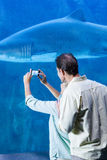 Happy couple taking a picture of a shark Royalty Free Stock Photography