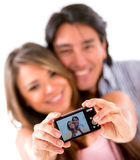 Happy couple taking a picture Royalty Free Stock Photo
