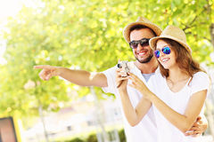 Happy couple taking pictures in the city Royalty Free Stock Photos