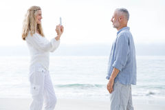 Happy couple taking pictures with mobile phone Royalty Free Stock Images