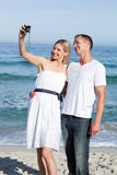 Happy couple taking pictures of themselves Stock Photos
