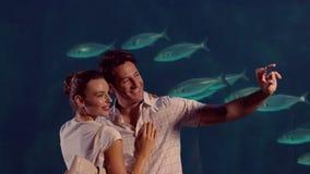 Happy couple taking a selfie at the aquarium stock video