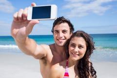 Happy couple taking selfie Stock Image