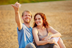 Happy couple taking selfie at beach Royalty Free Stock Photography