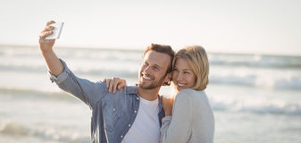 Happy couple taking selfie Stock Photo