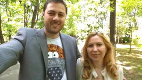 Happy couple taking a selfie film stock video