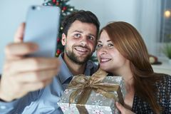 Happy couple is taking a selfie with gift Royalty Free Stock Photo