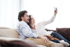 Happy couple taking selfie royalty free stock images