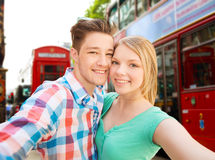 Happy couple taking selfie over london city Royalty Free Stock Photos