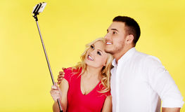 Happy couple taking selfie photo with selfie stick Stock Images