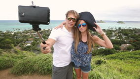 Happy couple taking selfie self-portrait photo hiking, Oahu, Hawaii stock video