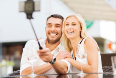 Happy couple taking selfie with smartphone at cafe Royalty Free Stock Images