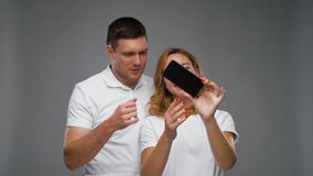 Happy couple taking selfie by smartphone stock footage