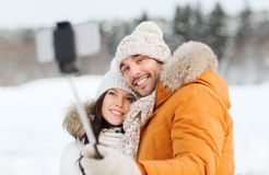 Happy couple taking selfie by smartphone in winter Stock Photos