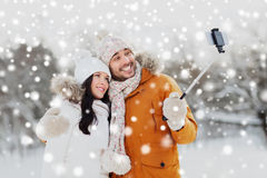 Happy couple taking selfie by smartphone in winter Royalty Free Stock Photo