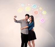 Happy couple taking selfie with smiley Royalty Free Stock Photography