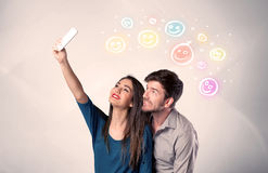 Happy couple taking selfie with smiley Stock Images