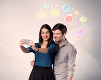 Happy couple taking selfie with smiley Stock Image