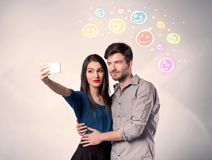 Happy couple taking selfie with smiley Stock Photography
