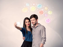 Happy couple taking selfie with smiley Stock Photo