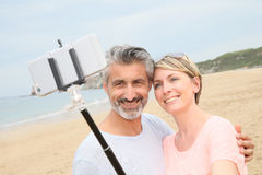 Happy couple taking selfie souvenir on holdays Royalty Free Stock Image