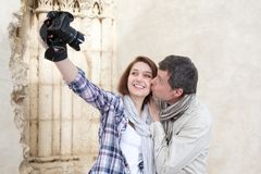 Happy couple taking selfie on the street. During Europe vacation royalty free stock images