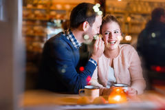 Happy couple talking at bar and having date Stock Image